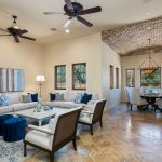 Great room and kitchen dining at Whisper Rock Luxury Home For Sale