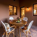 Bistro Relaxation at Whisper Rock Luxury Home For Sale
